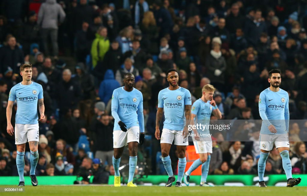 John Stones, Yaya Toure, Raheem Sterling, Alexander Zinchenko and Ilkay Gundogan of Manchester City look dejected as Bobby Reid of Bristol City scores their first goal during the Carabao Cup Semi-Final First Leg match between Manchester City and Bristol City at Etihad Stadium on January 9, 2018 in Manchester, England.