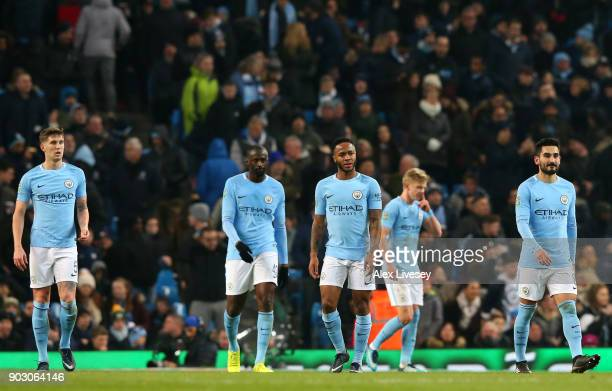 John Stones Yaya Toure Raheem Sterling Alexander Zinchenko and Ilkay Gundogan of Manchester City look dejected as Bobby Reid of Bristol City scores...