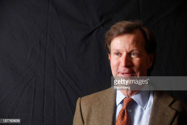 John Studzinski, senior managing director of Blackstone Group LP, poses for a photograph following a television interview during day two of the World...