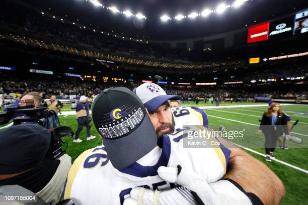 John Sullivan and Jared Goff of the Los Angeles Rams celebrate after defeating the New Orleans Saints in the NFC Championship game at the...