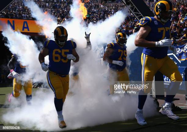 John Sullivan, Andrew Whitworth and Rob Havenstein of the Los Angeles Rams take the field prior to a game against the Seattle Seahawks at Los Angeles...