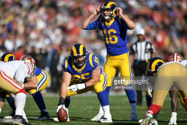 John Sullivan gets ready to snap the ball to Jared Goff of the Los Angeles Rams against the San Francisco 49ers at Los Angeles Memorial Coliseum on...