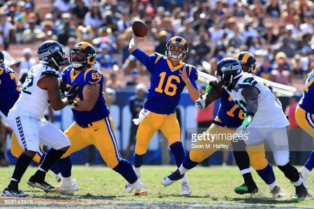John Sullivan of the Los Angeles Rams blocks as Jared Goff of the Los Angeles Rams passes the ball during the second half of a game against the...