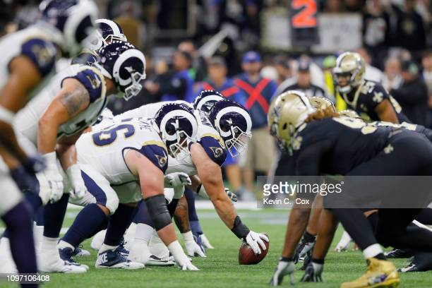 John Sullivan of the Los Angeles Rams prepares to snap a ball against the New Orleans Saints during the second quarter in the NFC Championship game...