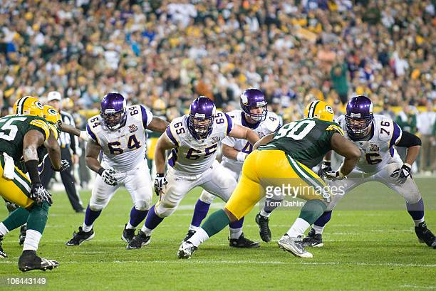 John Sullivan of the Minnesota Vikings blocks during a NFL game against the Green Bay Packers at Lambeau Field on October 23 2010 in Green Bay...