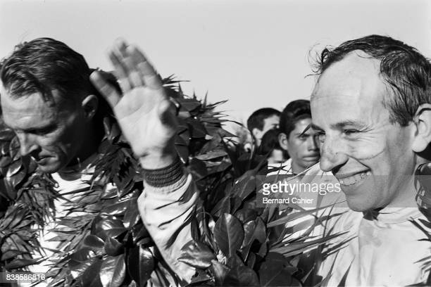 John Surtees Dan Gurney Grand Prix of Mexico Autodromo Hermanos Rodriguez 25 October 1964 The newly crowned 1964 World Champion John Surtees with...