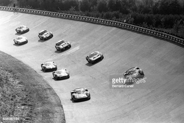 John Surtees, Mike Parkes, Ferrari 330P2, Ferrari 275P2, 1000 Km of Monza, Monza, 25 April 1965. Start of the 1000 Km race on the Monza banking.