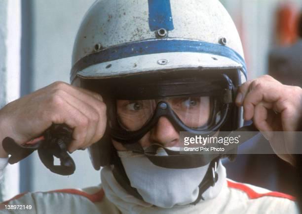 John Surtees of Great Britain, driver of the Honda Racing Honda RA273 Honda V12 adjusts his goggles before the II Race of Champions on 12th March...