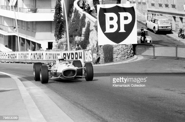John Surtees roars up the Sainte Devote hill toward the Casino in the Honda V12 during the Monaco Grand Prix Monte Carlo 7th May 1967 He had...