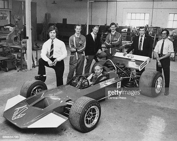 John Surtees sits aboard the Surtees TS7 Cosworth DFV V8 whilst surrounded by car designer Peter Connew, mechanic Roger Flynn, Rex Stone, Bill...