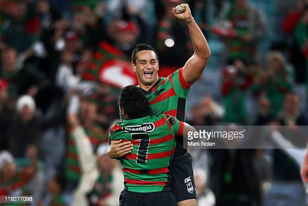 John Sutton and Chris Sandow of the Rabbitohs celebrate a field goal in extra time by Sandow to win the round 19 NRL match between the South Sydney...