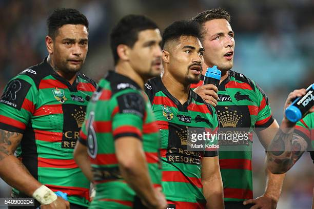 John Sutton Cody Walker Kirisome Auva'a and Sam Burgess of the Rabbitohs look dejected after a try during the round 15 NRL match between the South...