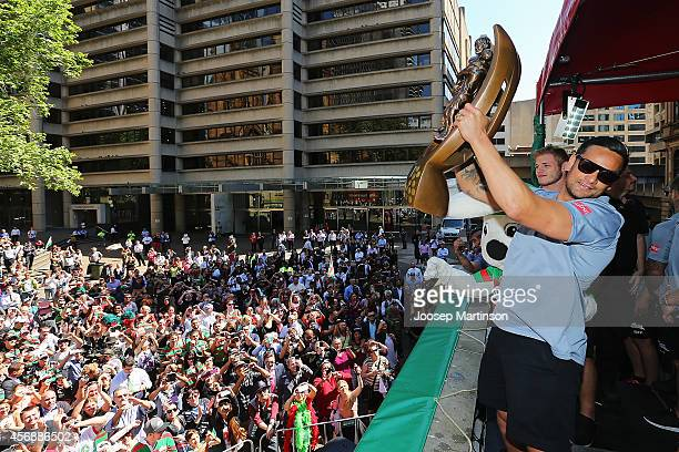John Sutton holds up the trophy during a South Sydney Rabbitohs NRL Grand Final celebration at Sydney Town Hall on October 9 2014 in Sydney Australia