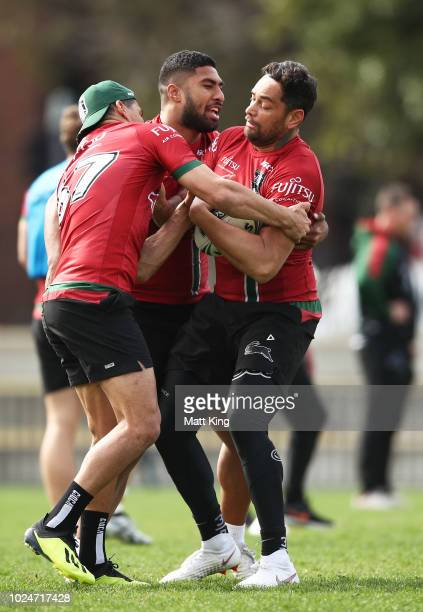John Sutton is tackled by Robert Jennings during a South Sydney Rabbitohs NRL training session at Redfern Oval on August 28 2018 in Sydney Australia