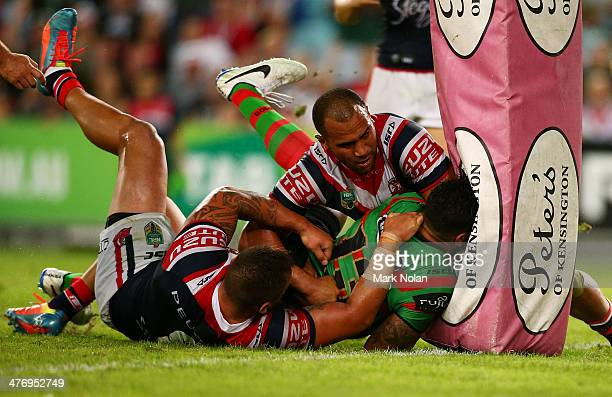 John Sutton of the Rabbioths is tackled into the goal post pads during the round one NRL match between the South Sydney Rabbitohs and the Sydney...