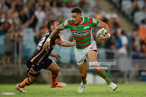 John Sutton of the Rabbitohs breaks free from a tackle during the round three NRL match between the Wests Tigers and the South Sydney Rabbitohs at...