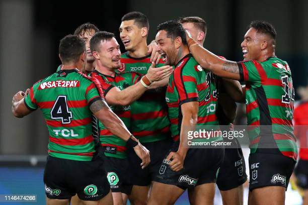 John Sutton of the Rabbitohs celebrates scoring a try during the round eight NRL match between the South Sydney Rabbitohs and the Brisbane Broncos at...