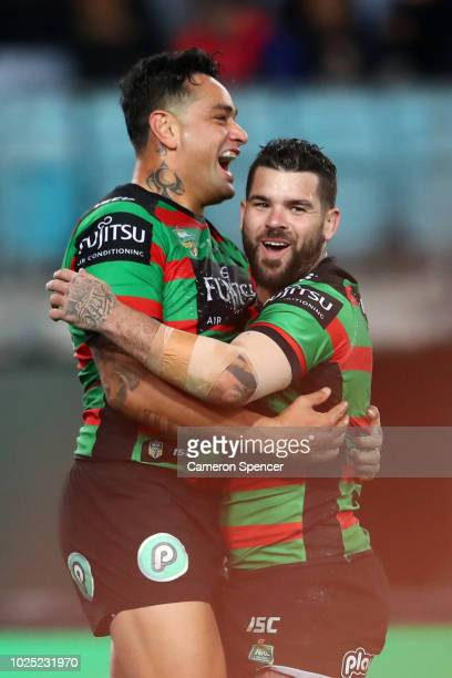 John Sutton of the Rabbitohs celebrates scoring a try with team mate Adam Reynolds of the Rabbitohs during the round 25 NRL match between the South...