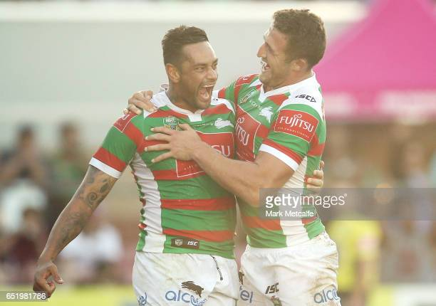 John Sutton of the Rabbitohs celebrates scoring a try with team mate Sam Burgess during the round two NRL match between the Manly Sea Eagles and the...
