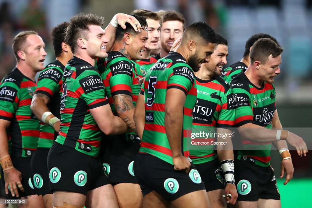 John Sutton of the Rabbitohs celebrates scoring a try with team mates during the round 25 NRL match between the South Sydney Rabbitohs and the Wests Tigers at ANZ Stadium on August 30, 2018 in Sydney, Australia.