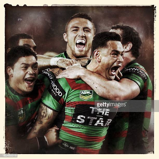 John Sutton of the Rabbitohs celebrates with team mates after scoring the first try during the NRL Preliminary Final match between the South Sydney...