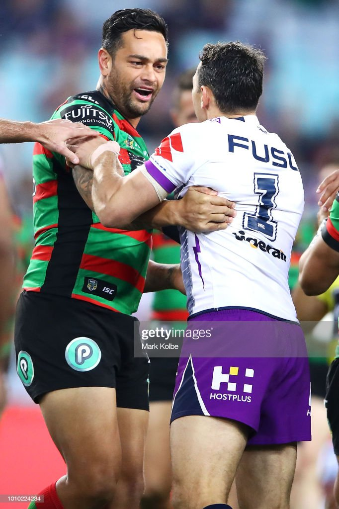 John Sutton of the Rabbitohs exchanges words with Billy Slater of the Storm during the round 21 NRL match between the South Sydney Rabbitohs and the Melbourne Storm at ANZ Stadium on August 3, 2018 in Sydney, Australia.