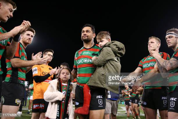 John Sutton of the Rabbitohs is given a guard of honour by his team mates as he walks from the field with his children following the NRL Preliminary...