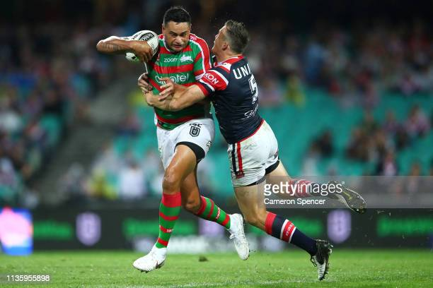 John Sutton of the Rabbitohs is tackled by Brett Morris of the Roosters during the round one NRL match between the Sydney Roosters and the South...