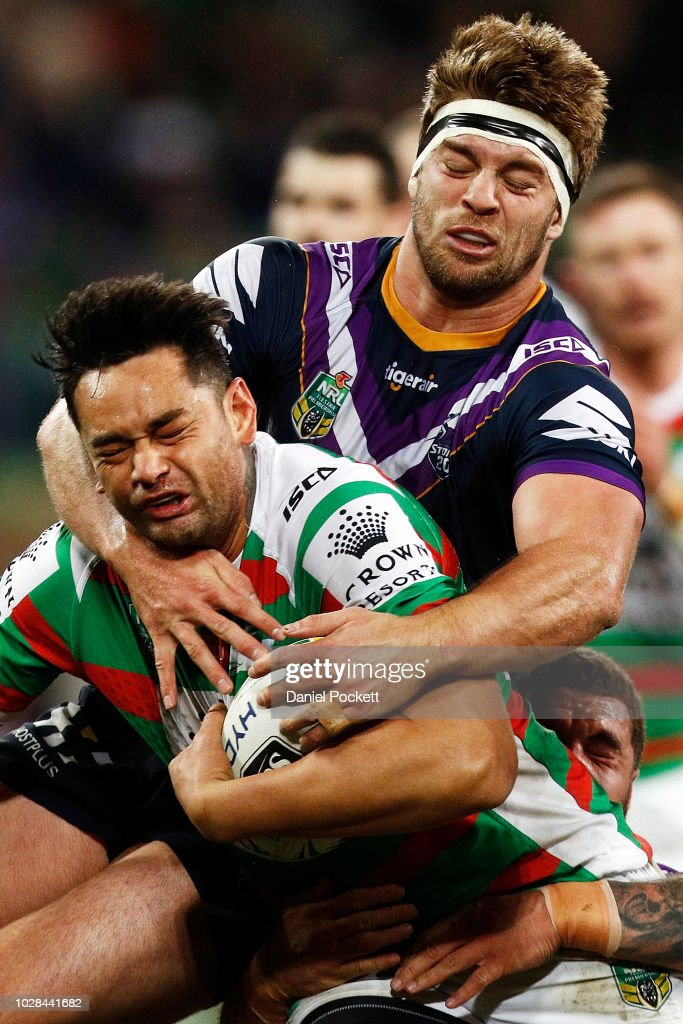 John Sutton of the Rabbitohs is tackled by Christian Welch of the Storm during the NRL Qualifying Final match between the Melbourne Storm and the South Sydney Rabbitohs at AAMI Park on September 7, 2018 in Melbourne, Australia.
