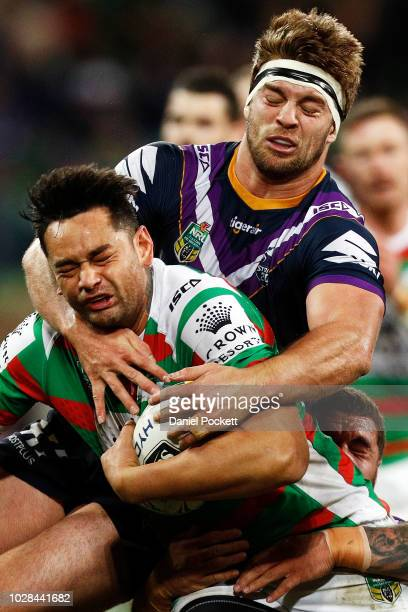 John Sutton of the Rabbitohs is tackled by Christian Welch of the Storm during the NRL Qualifying Final match between the Melbourne Storm and the...