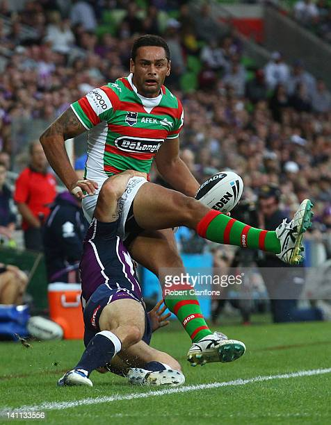 John Sutton of the Rabbitohs is tackled by Cooper Cronk of the Storm during the round two NRL match between the Melbourne Storm and the South Sydney...