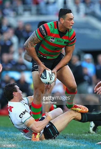 John Sutton of the Rabbitohs is tackled by David Simmons during the round 17 NRL match between the South Sydney Rabbitohs and the Penrith Panthers at...