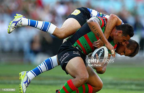 John Sutton of the Rabbitohs is tackled by Josh Reynolds of the Bulldogs during the round six NRL match between the South Sydney Rabbitohs and the...