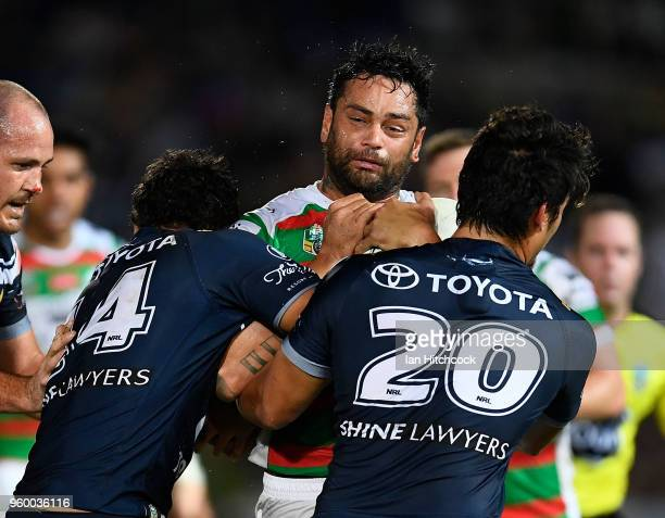 John Sutton of the Rabbitohs is tackled by Te Maire Martin and Enari Tuala of the Cowboys during the round 11 NRL match between the North Queensland...