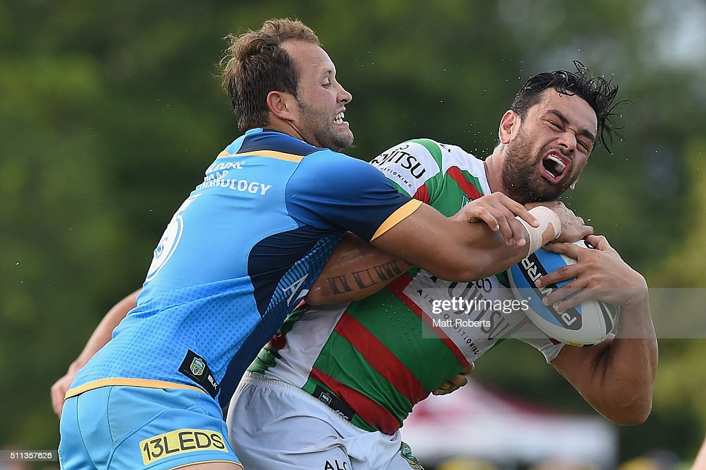 John Sutton of the Rabbitohs is tackled by Tyrone Roberts of the Titans during the NRL trial match between the Gold Coast Titans and the South Sydney Rabbitohs at Pizzey Park on February 20, 2016 on the Gold Coast, Australia.