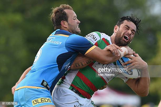 John Sutton of the Rabbitohs is tackled by Tyrone Roberts of the Titans during the NRL trial match between the Gold Coast Titans and the South Sydney...