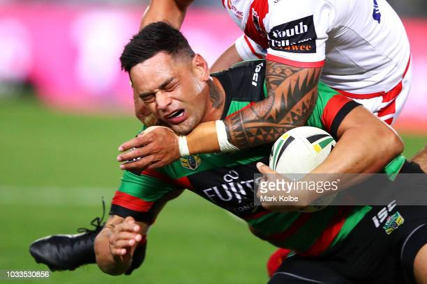 John Sutton of the Rabbitohs is tackled during the NRL Semi Final match between the South Sydney Rabbitohs and the St George Illawarra Dragons at ANZ...