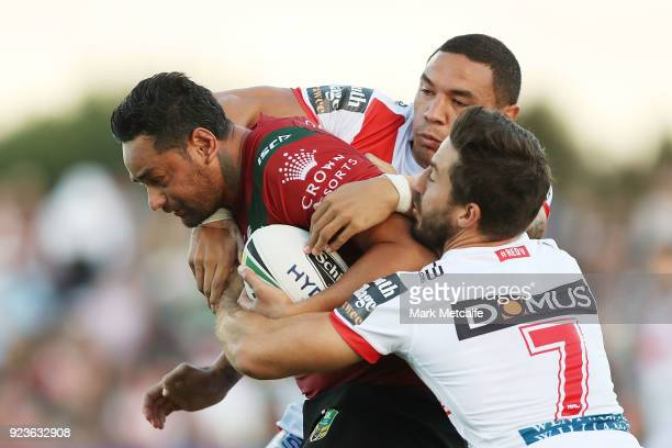 John Sutton of the Rabbitohs is tackled during the NRL trial match between the South Sydney Rabbitohs and the St George Illawarra Dragons at Glen...
