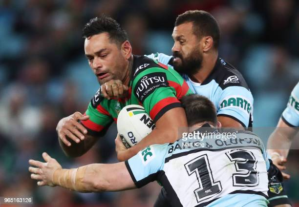 John Sutton of the Rabbitohs is tackled during the round 13 NRL match between the South Sydney Rabbitohs and the Cronulla Sharks at ANZ Stadium on...