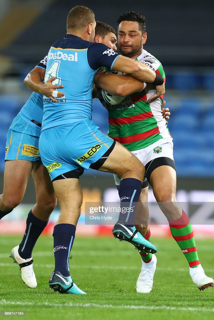 John Sutton of the Rabbitohs is tackled during the round 14 NRL match between the Gold Coast Titans and the South Sydney Rabbitohs at Cbus Super Stadium on June 8, 2018 in Gold Coast, Australia.
