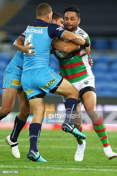 John Sutton of the Rabbitohs is tackled during the round 14 NRL match between the Gold Coast Titans and the South Sydney Rabbitohs at Cbus Super...