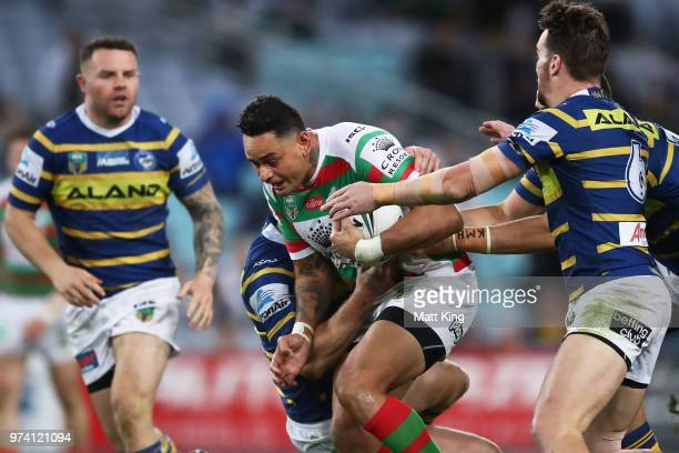 John Sutton of the Rabbitohs is tackled during the round 15 NRL match between the Parramatta Eels and the South Sydney Rabbitohs at ANZ Stadium on...