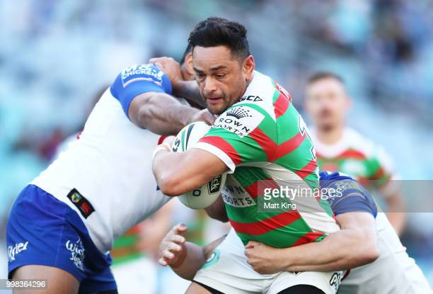 John Sutton of the Rabbitohs is tackled during the round 18 NRL match between the Canterbury Bulldogs and the South Sydney Rabbitohs at ANZ Stadium...