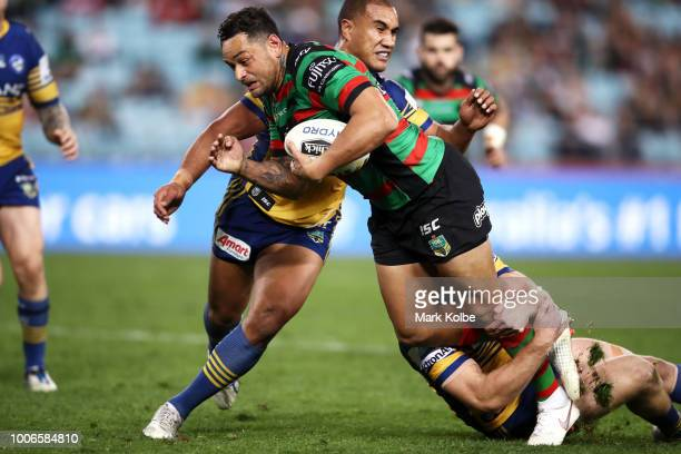 John Sutton of the Rabbitohs is tackled during the round 20 NRL match between the South Sydney Rabbitohs and the Parramatta Eels at ANZ Stadium on...