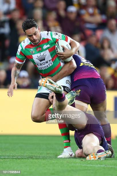 John Sutton of the Rabbitohs is tackled during the round 23 NRL match between the Brisbane Broncos and the South Sydney Rabbitohs at Suncorp Stadium...