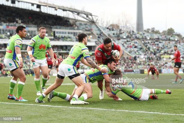 John Sutton of the Rabbitohs is tackled during the round 24 NRL match between the Canberra Raiders and the South Sydney Rabbitohs at GIO Stadium on...