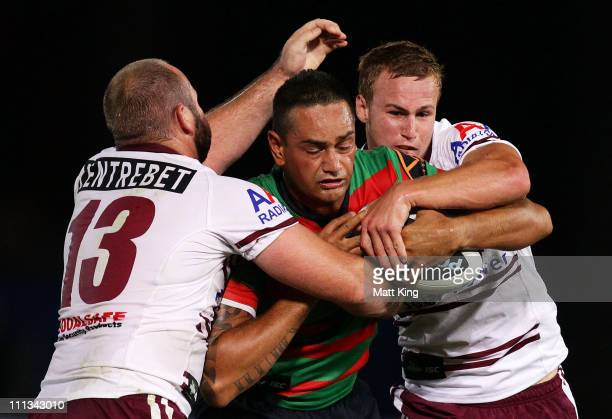 John Sutton of the Rabbitohs is tackled during the round four NRL match between the South Sydney Rabbitohs and the Manly Warringah Sea Eagles at...