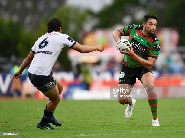 John Sutton of the Rabbitohs looks to get past Enari Tuala of the Cowboys during the round 16 NRL match between the South Sydney Rabbitohs and the...