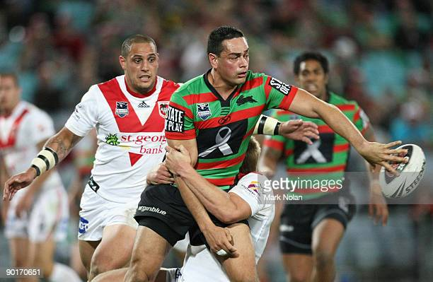 John Sutton of the Rabbitohs offloads during the round 25 NRL match between the South Sydney Rabbitohs and the St George Illawarra Dragons at ANZ...