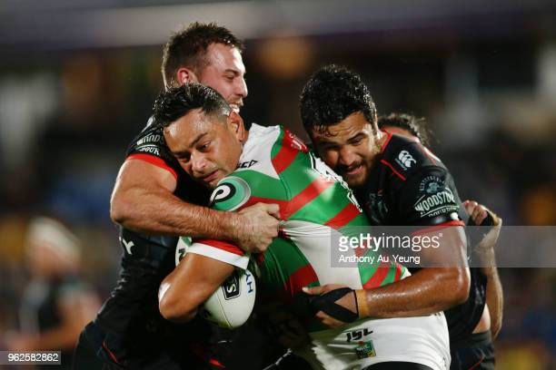 John Sutton of the Rabbitohs on the charge against Karl Lawton and Peta Hiku of the Warriors during the round 12 NRL match between the New Zealand...